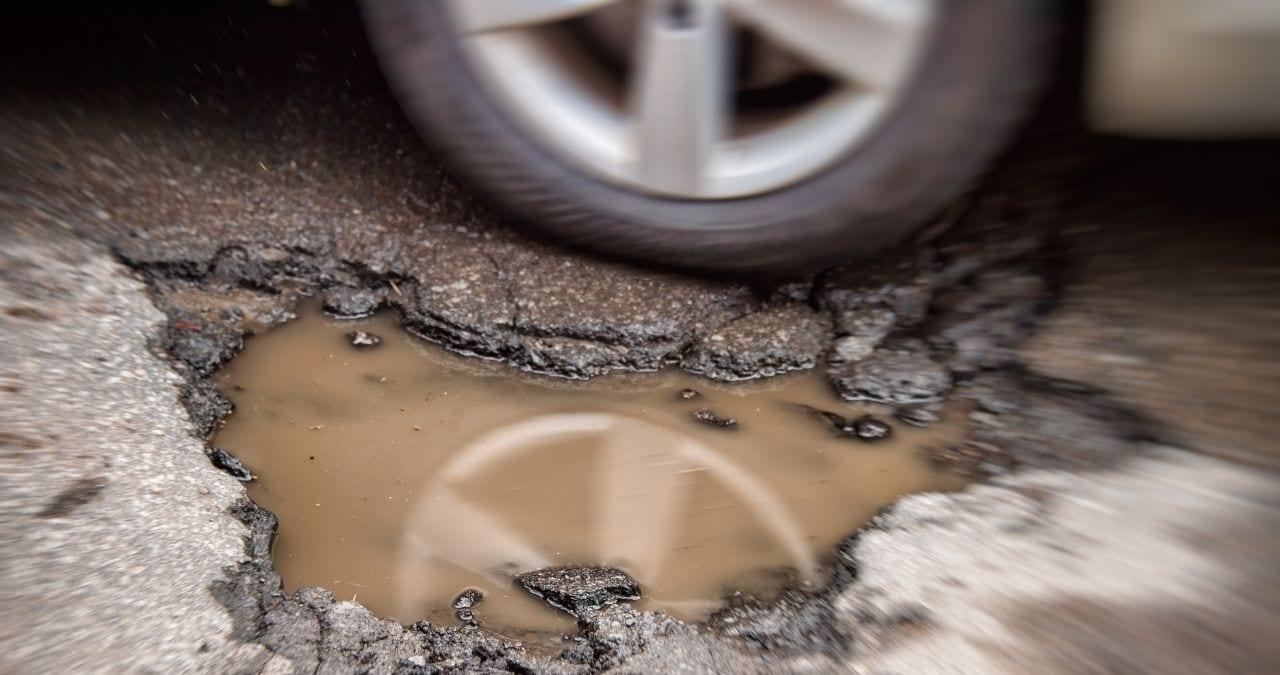 car damaged pothole